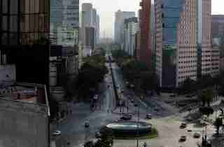 A general view shows the partially empty Reforma Avenue after Mexico's government declared a health emergency on Monday and issued stricter rules aimed at containing the fast-spreading coronavirus disease (COVID-19), in Mexico City, Mexico March 31, 2020. REUTERS/Henry Romero