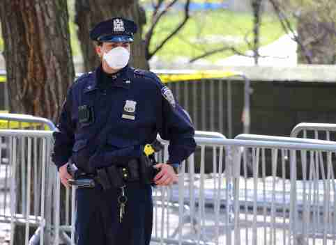 New York City Police officer with face mask on Fifth Avenue during the coronavirus pandemic in New York City, NY, USA on April 1, 2020. New York City has become the epicenter of coronavirus in the U.S with over 47,000 cases. The pandemic has forced millions of New Yorkers into their homes as local and state government enforce another 30 day stay-at-home order to try and flatten the curve. Photo by Charles Guerin/ABACAPRESS.COM