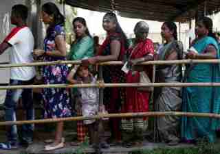 People stand in a queue outside a polling station during the Maharashtra state elections in Mumbai, India, October 21, 2019. REUTERS/Francis Mascarenhas - RC1E9B4C56C0