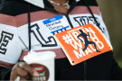A woman wears a name tag and running bib protesting the shooting death of Ahmaud Arbery at the Glynn County Courthouse on May 8, 2020, in Brunswick, Georgia. Sean Rayford/Getty Images