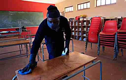 DURBAN, SOUTH AFRICA- Cleaning workers perform disinfection tasks in schools in Durban, South Africa on May 29, 2020. The South African government announced the reopening of the schools on June 1 after being closed for 3 months due to the pandemic of the coronavirus. (NO RESALE)