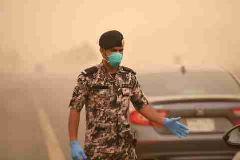 TABUK, SAUDI ARABIA- Police and military carry out health checks on drivers as a preventive measure against the coronavirus in Tabuk, Saudi Arabia on April 14, 2020. King Salman of Saudi Arabia extended the curfew throughout the country until new notice due to the spread of the new Covid-19 coronavirus, as reported on Sunday (12) by the Interior Ministry. Saudi Arabia placed its capital Riyadh and other major cities under a 24-hour curfew, blocking much of the population from stopping the spread of the Covid-19 coronavirus.