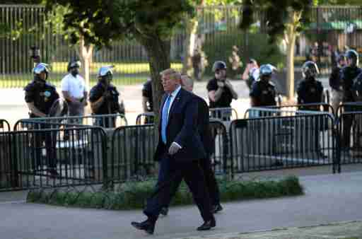 U.S. President Donald Trump walks through Lafayette Park to visit St. John's Episcopal Church across from the White House during ongoing protests over racial inequality in the wake of the death of George Floyd while in Minneapolis police custody, in the Rose Garden at the White House in Washington, U.S., June 1, 2020. REUTERS/Tom Brenner