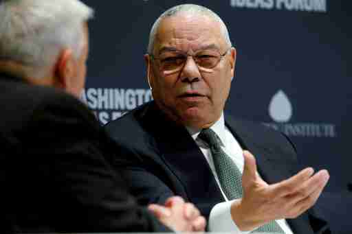 FILE PHOTO: Former U.S. Secretary of State Colin Powell (R) takes part in an onstage interview with Aspen Institute President and CEO Walter Isaacson (L) at the Washington Ideas Forum in Washington, September 30, 2015. REUTERS/Jonathan Ernst/File Photo