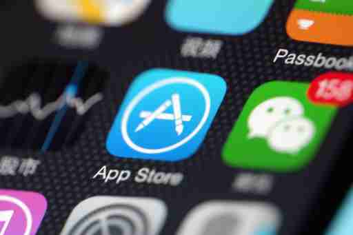 --FILE--A Chinese mobile phone user shows the icons of App Store app, left, and messaging app Weixin, or WeChat, of Tencent on his iPhone smartphone in Ji'nan city, east China's Shandong province, 27 June 2017.Apple China said it will not take the blame for developers who charge differently on the iOS app and Android versions for the same product or service. Netizens have found they need to pay more on iOS than Android in using the same ride-sharing or video subscription services. Some Internet companies have reportedly adopted differential pricing plans through the use of Big Data based on a customer's buying behavior or interest, so a new customer may pay less than an old customer for the same product or service.No Use China. No Use France.