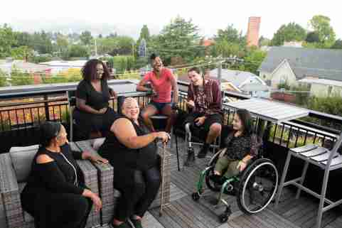 Disabled women talk together