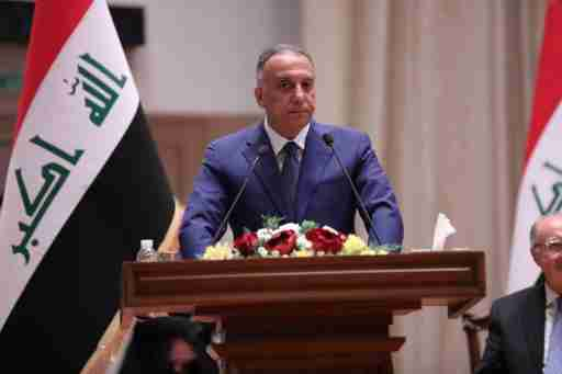 Iraqi Prime Minister-designate Mustafa al-Kadhimi delivers a speech during the vote on the new government at the parliament headquarters in Baghdad, Iraq, May 7, 2020. Iraqi Parliament Media Office/Handout via REUTERS ATTENTION EDITORS - THIS PICTURE WAS PROVIDED BY A THIRD PARTY.