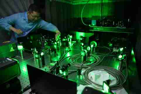 A Chinese researcher works on an ultracold atom device at the CAS-Alibaba Quantum Computing Laboratory in Shanghai, China