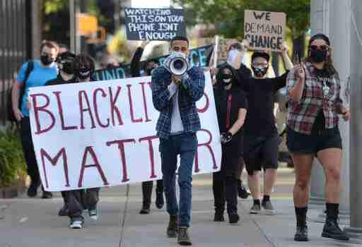 Aug 29, 2020; Erie, PA, USA; Erie Equal founder Andrey Rosado, center, leads protesters as they march past Erie City Hall during the We Will Not Stay Silent rally on Aug. 29, 2020. The rally, organized by Erie Equal, was in response to the social unrest and violence in Kenosha, Wisconsin and other cites across the country. Mandatory Credit: Jack Hanrahan/Erie Times-News-USA TODAY NETWORK