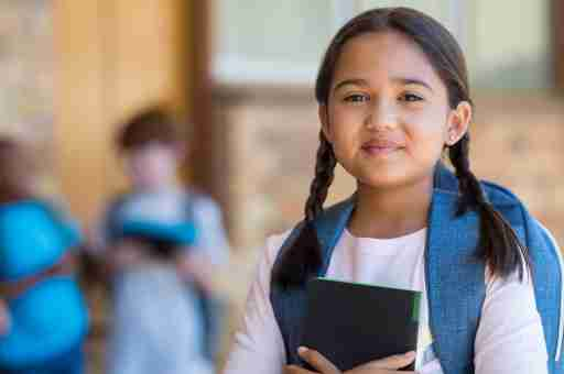 smiling girl getting ready for school