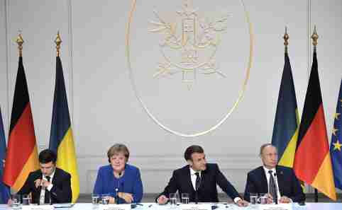 (L-R) Ukrainian President Volodymyr Zelensky, German Chancellor Angela Merkel, French President Emmanuel Macron, and Russian President Vladimir Putin, attend a joint press conference at the Elysee Palace after holding the Normandy Format Summit. Russia has expressed doubts that a planned Berlin summit to resolve the Ukraine conflict will in fact take place, with Deputy Foreign Minister Andrey Rudenko saying Kiev has done little to fulfil agreements made at an earlier summit between the warring sides.