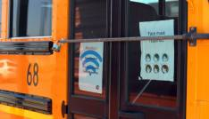 Flyers are posted on the doors of Deming Public School bus 68 near the Mexican border in Columbus, NM. The flyers give students the username and password for internet access and also remind students to wear masks.Bus2