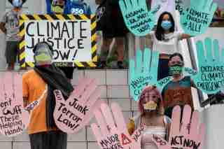 Filipino climate activists hold placards calling for climate action in participation with the global climate change protests, in Quezon City, Metro Manila, Philippines, September 25, 2020. REUTERS/Eloisa Lopez