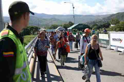 People cross the Colombian-Venezuelan border over the partially opened Simon Bolivar international bridge in San Antonio del Tachira, Venezuela June 8, 2019. REUTERS/Carlos Eduardo Ramirez