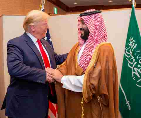 Saudi Arabia's Crown Prince Mohammed bin Salman shakes hands with U.S. President Donald Trump, at the G20 leaders summit in Osaka, Japan, June 29, 2019. Bandar Algaloud/Courtesy of Saudi Royal Court/Handout via REUTERS ATTENTION EDITORS - THIS PICTURE WAS PROVIDED BY A THIRD PARTY.