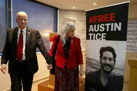 Marc and Debra Tice, parents of U.S. journalist Austin Tice, walk past a poster of their son after the news conference in Beirut, Lebanon December 4, 2018. REUTERS/Mohamed Azakir