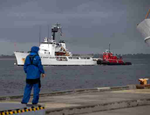 The U.S Coast Guard Cutter Diligence (WMEC-616) arrives at its new homeport at Naval Air Station Pensacola on a stormy day Monday, July 27, 2020. The 210-foot Reliance-class cutter joins the cutters Decisive and the Dauntless currently calling Pensacola home.Uscg Homeport Diligence