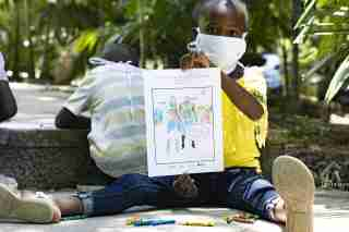 """Port-au-Prince, Haiti.- In the April 24, 2020 file photo, children in Haiti try to educate themselves amid the coronavirus pandemic (COVID-19). The socioeconomic effects of the coronavirus pandemic could set back """"decades"""" the progress made in the education of girls and adolescents in Latin America and the Caribbean, many of which may """"never return to the classroom"""", as it has warned this Tuesday, International Plan. The NGO estimates that currently some 500 million children and young people around the world are not receiving distance education, """"something that is having devastating consequences in Latin America and the Caribbean"""", where more than 95 percent of minors have remained outside of classrooms without many of them being able to follow classes online."""