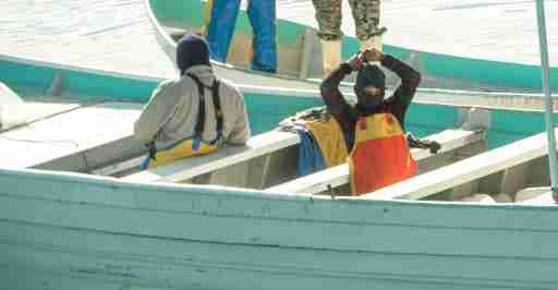 Masked men on skiffs are seen fishing illegally inside the Vaquita Refuge, a UNESCO World Heritage Site located in Mexico's Upper Gulf of California, off San Felipe, Baja California, Mexico March 3, 2020 in this picture released by the Sea Shepherd. Sea Shepherd/Handout via REUTERS   ATTENTION EDITORS - THIS IMAGE HAS BEEN SUPPLIED BY A THIRD PARTY. MANDATORY CREDIT SEA SHEPHERD.