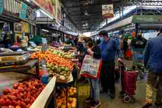 People work in a market in Santiago de Chile, Chile.