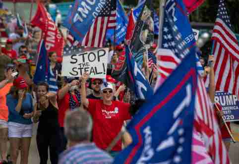 Trump supporters cheer as they march to protest the election outcome