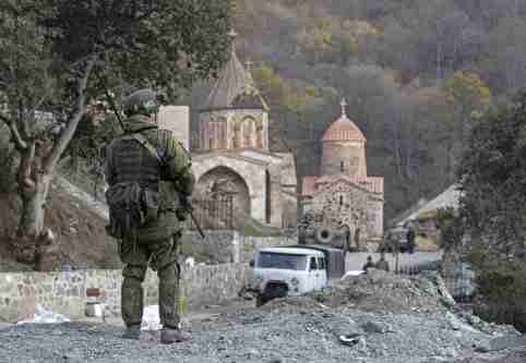 NAGORNO-KARABAKH - NOVEMBER 15, 2020: A Russian peacekeeper guards the area near the Dadivank monastery. On 10 November, Armenia's Prime Minister Nikol Pashinyan, Russia's President Vladimir Putin, and Azerbaijan's President Ilham Aliyev signed a joint statement on a complete ceasefire in Nagorno-Karabakh. The Russian leader said the Azerbaijani and Armenian sides would maintain the positions that they had held and Russian peacekeepers would be deployed to the region. According to the document, Armenia has to hand over the Nagorno-Karabakh districts of Kalbajar, Lachin, and Agdam, to Azerbaijan till November 15, December 1, and November 20, respectively. Stanislav Krasilnikov/TASS.No use Russia.