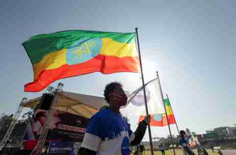 A volunteer holds an Ethiopian flag during a blood donation ceremony for the injured members of Ethiopia's National Defense Forces (ENDF) fighting against Tigray's special forces on the border between Amhara and Tigray, at the stadium in Addis Ababa, Ethiopia November 12, 2020. REUTERS/Tiksa Negeri