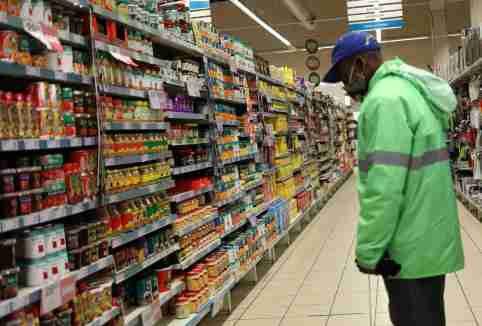 A shopper wearing a face mask looks at grocery items, amid the spread of the coronavirus disease (COVID-19) at Mall of the south, in Johannesburg, South Africa, June 17, 2020. REUTERS/Siphiwe Sibeko