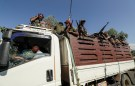 FILE PHOTO: Members of Amhara segment militias float on their lorry as they conduct to face a Tigray People's Liberation Front (TPLF), in Sanja, Amhara segment nearby a limit with Tigray, Ethiopia Nov 9, 2020. REUTERS/Tiksa Negeri/File Photo