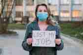 "stock image of women holding sign that says, ""Lost My Job"""