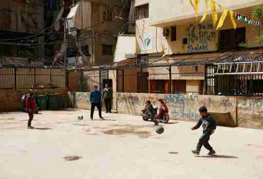 Boys play with balls in Shatila Palestinian refugee camp, as the spread of coronavirus disease (COVID-19) continues, in Beirut suburbs, Lebanon March 30, 2020. Picture taken March 30, 2020. REUTERS/Mohamed Azakir