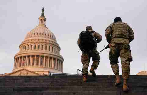 National Guard members walk at the Capitol, in Washington, U.S., January 15, 2021. REUTERS/Joshua Roberts     TPX IMAGES OF THE DAY