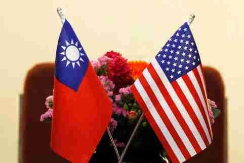FILE PHOTO: Flags of Taiwan and U.S. are placed for a meeting between U.S. House Foreign Affairs Committee Chairman Ed Royce speaks and with Su Chia-chyuan, President of the Legislative Yuan in Taipei, Taiwan March 27, 2018. REUTERS/Tyrone Siu