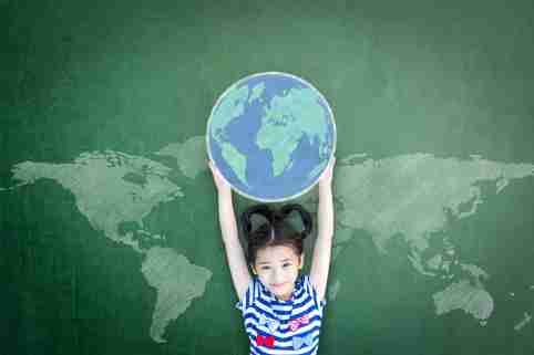 Girl holds a globe above her head.
