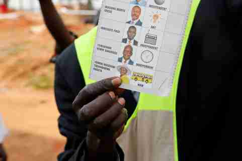 An election official shows a ballot after polling stations closed during the presidential elections in Kampala, Uganda, January 14, 2021. REUTERS/Baz Ratner