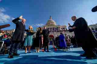 FILE PHOTO: Joe Biden is sworn in as the 46th president of the United States by Chief Justice John Roberts as Jill Biden holds the Bible during the 59th Presidential Inauguration at the U.S. Capitol, in Washington, U.S., January 20, 2021. Andrew Harnik/Pool via REUTERS/File Photo