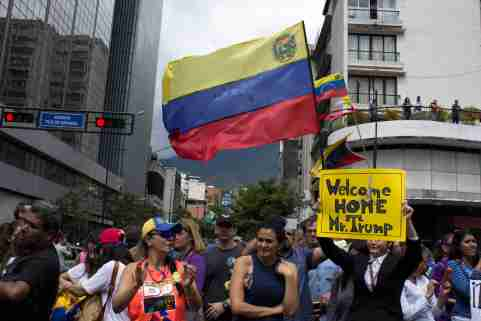 Caracas/Venezuela - January 30, 2019: Protesters hold banners welcoming Donald Trump aggressive moves on Venezuela and Juan Guaido, the U.S. backed opposition leader declared interim presiden