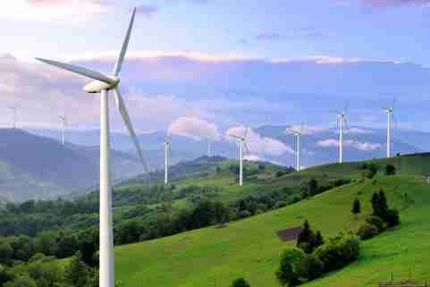Wind turbines on a hillside.