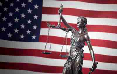 Law, legal, judge concept. Lady justice with USA flag in background