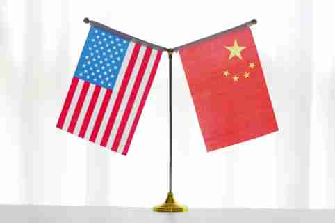 "--FILE--National flags of China and the United States are seen in Ji'nan city, east China's Shandong province, 14 June 2018.Even as Chinese and American trade negotiators laid plans to maintain ""intensive consultation"" this month, President Donald Trump said he will impose 10% tariffs Sept. 1 on an additional $300 billion a year of imports from China. Trump disclosed the expansion of tariffs Thursday in a tweet in which he also complained that China failed to increase agricultural purchases and to cut off the flow of the opioid drug fentanyl to the U.S. from China as he said President Xi Jinping promised. Trump said the new duties will be in addition to the tariffs of as much as 25% on $250 billion a year of Chinese imports. The Dow Jones Industrial Average plunged 200 points following the news, erasing a gain of 300 points earlier in the day. China didn't immediately respond to Trump's tweet, which he concluded by writing, ""We look forward to continuing our positive dialogue with China.""No Use China. No Use France."