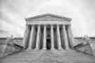 Black and white photograph of the Supreme Court building.