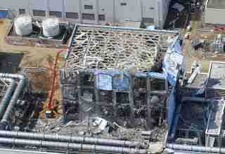 """FILE PHOTO: An aerial view of the Fukushima Daiichi Nuclear Power Station is seen in Fukushima Prefecture in this photo taken by the Air Photo Service on March 24, 2011. Mandatory Credit Air Photo Service/Handout via REUTERS/File Photo ATTENTION EDITORS - MANDATORY CREDIT.  THIS IMAGE HAS BEEN SUPPLIED BY A THIRD PARTY. SEARCH """"10TH ANNIVERSARY OF JAPAN'S QUAKE, TSUNAMI AND NUCLEAR DISASTER"""" FOR THE PHOTOS."""