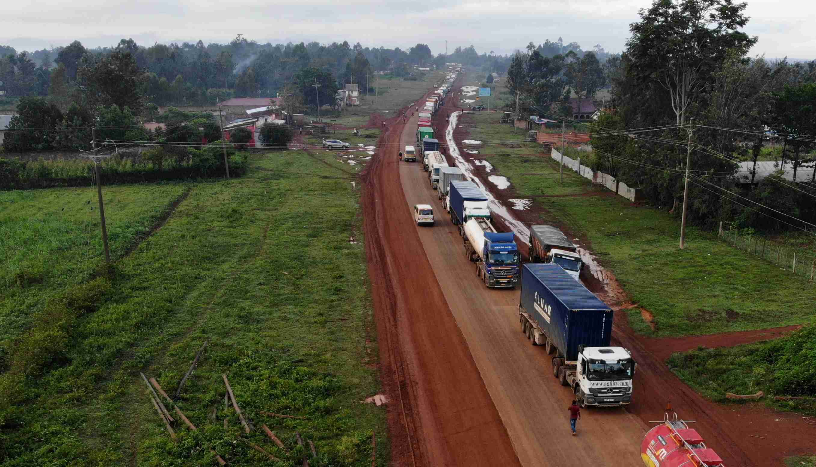 Parked trucks wait in a 10km queue, to cross the Kenyan-Ugandan border from the town of Busia, Kenya November 14, 2020. Picture taken November 14, 2020. REUTERS/Baz Ratner