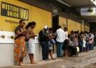Zimbabweans reserve outward a Western Union bend in Harare, Zimbabwe, Feb 26, 2019. REUTERS/Philimon Bulawayo