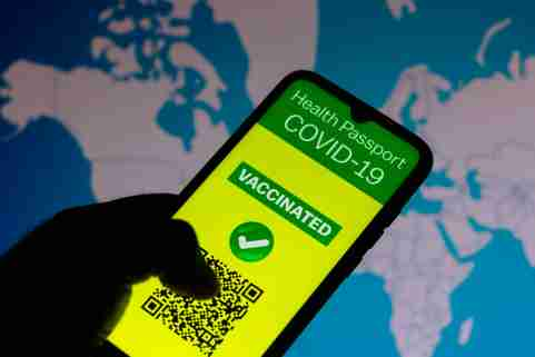 A vaccination passport application for COVID-19 is displayed on a smartphone.