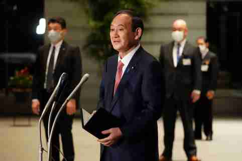 Japanese Prime Minister Yoshihide Suga speaks to media after announcing that Tokyo, Kyoto and Okinawa will have pre-emergency status under a new prevention law during a government task force meeting at the prime minister's office, Tokyo, Japan, April 9, 2021. Eugene Hoshiko/Pool via Reuters