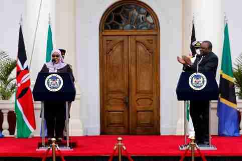 Tanzanian President Samia Suluhu Hassan and Kenya's President Uhuru Kenyatta attand a joint statement at State House, in Nairobi, Kenya, May 4, 2021. REUTERS/Baz Ratner