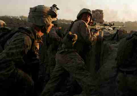 FILE PHOTO: U.S. Marines fire during a Taliban ambush as they carry out an operation to clear an area in Helmand province, Afghanistan, October 9, 2009. REUTERS/Asmaa Waguih/File Photo