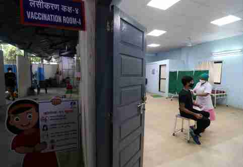 Person receives their first dose of a COVID-19 vaccine in Mumbai, India.
