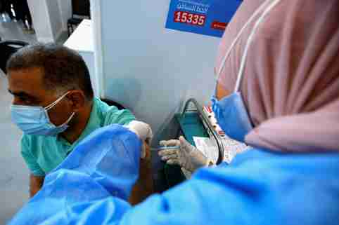 A man receives a dose of the China's Sinopharm vaccine against the coronavirus disease (COVID-19) at a mass immunization venue inside Cairo's International Exhibition Center in Cairo, Egypt June 5, 2021. REUTERS/Amr Abdallah Dalsh